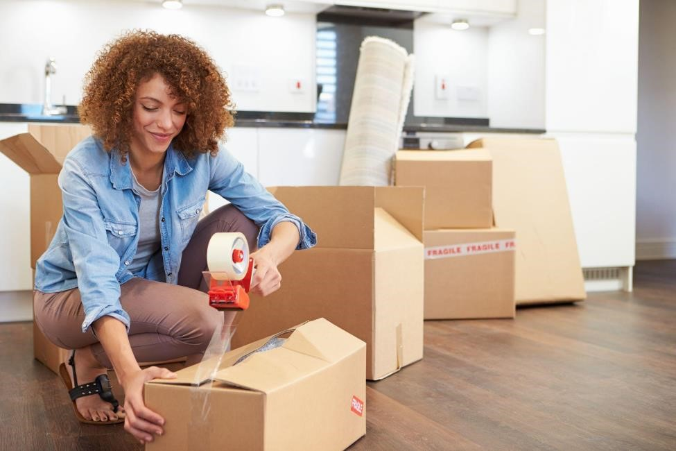 Woman using moving and packing supplies